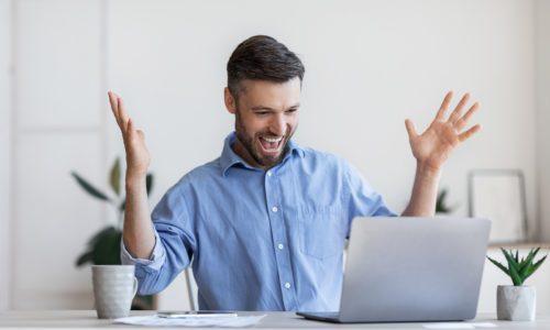 man celebrates project team success